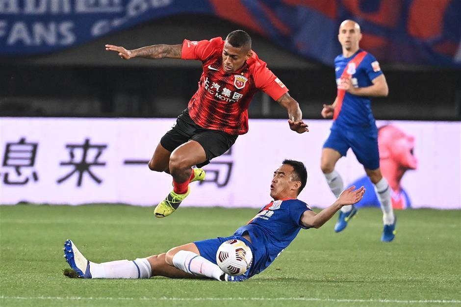 Late Bassogog penalty earns Shenhua draw in Shanghai derby