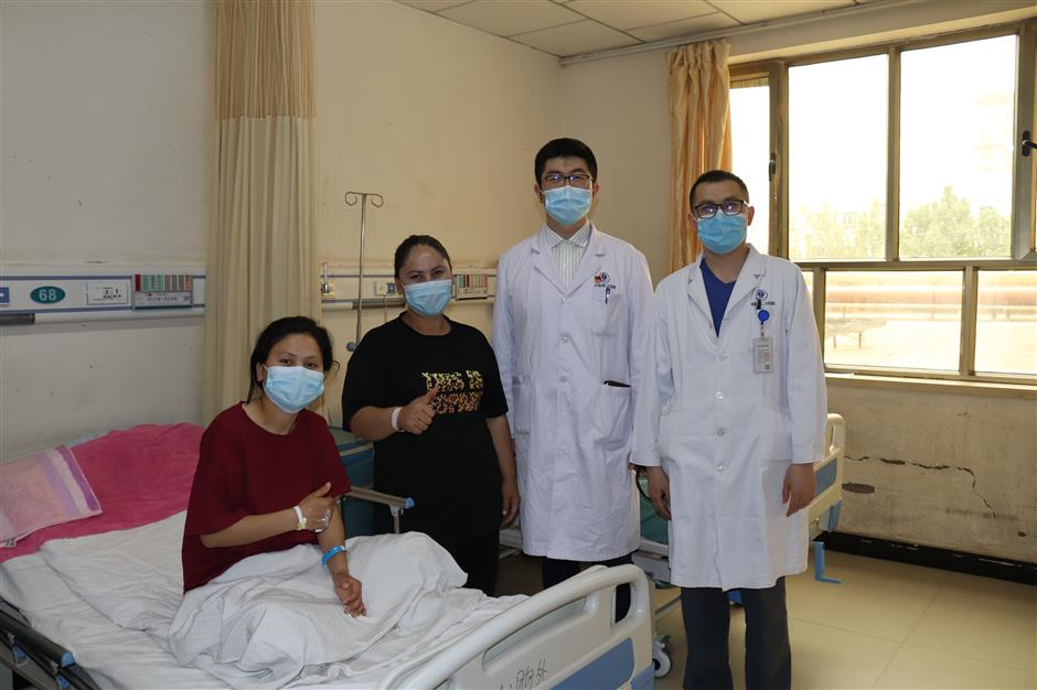 Xinjiang student in good heart after successful surgery