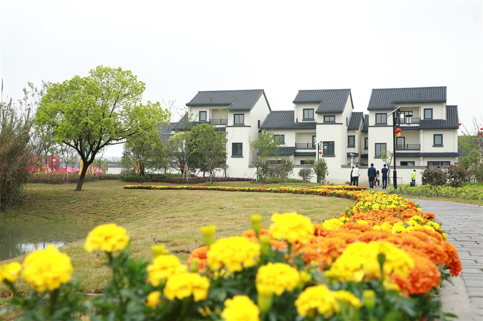 Delighted villagers get keys to new homes