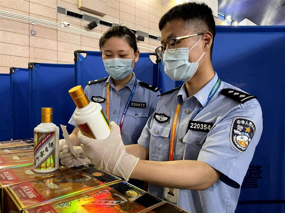 Passenger found with 82 bottles of Moutai