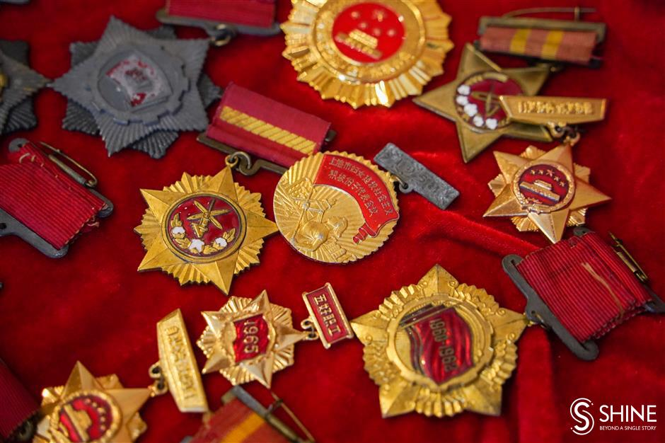 Model worker donates medals, certificates to city archives