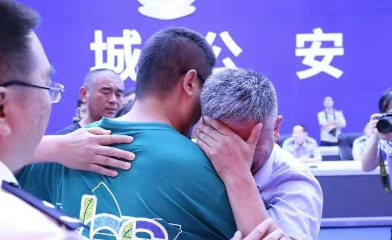 Family in tearful reunion with their son after 24 years