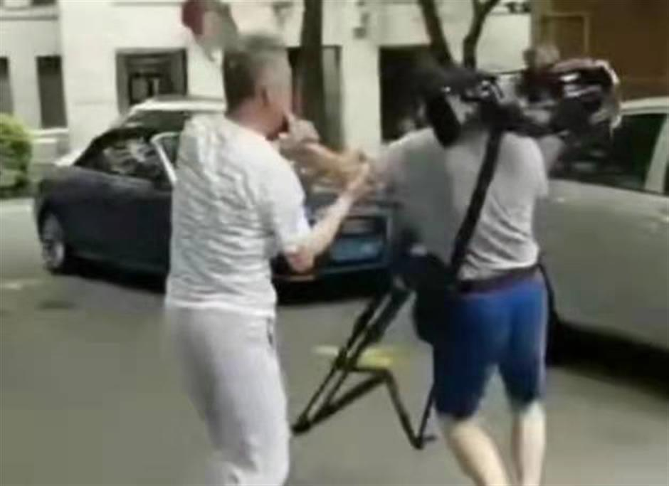 Man detained after allegedly assaulting reporters