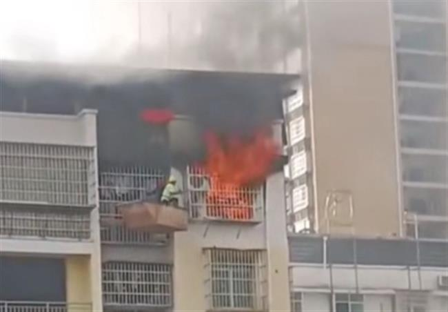 2 workers ride crane to rescue boy from burning room