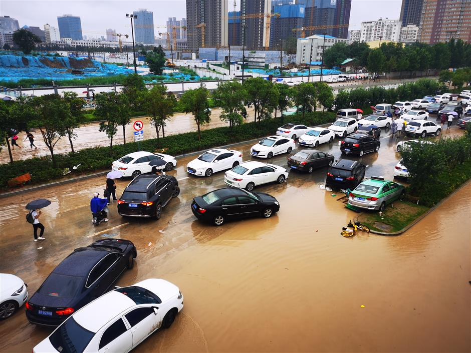 China on second-highest emergency response as downpours, flooding continue in central province