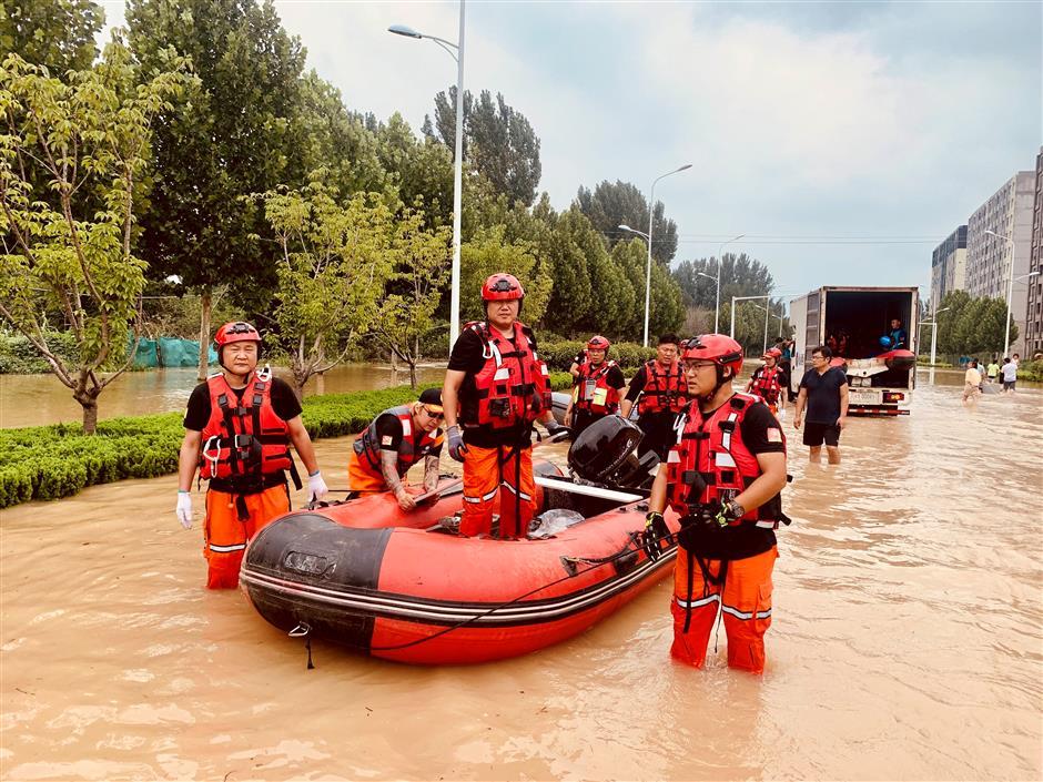Zhoupu disaster experts rescue thousands in flood-devastated Zhengzhou