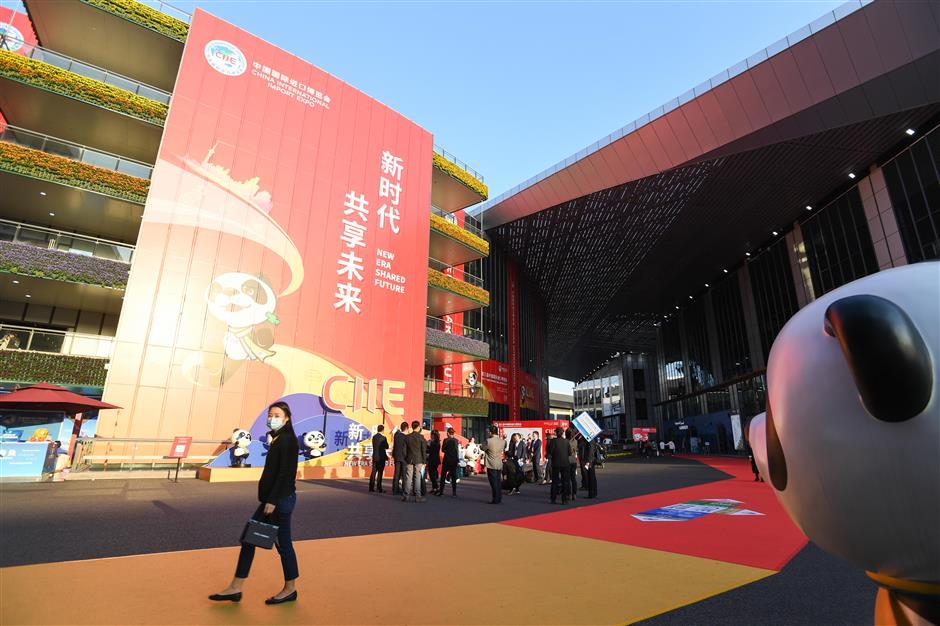 Companies heading for CIIE stay upbeat about China