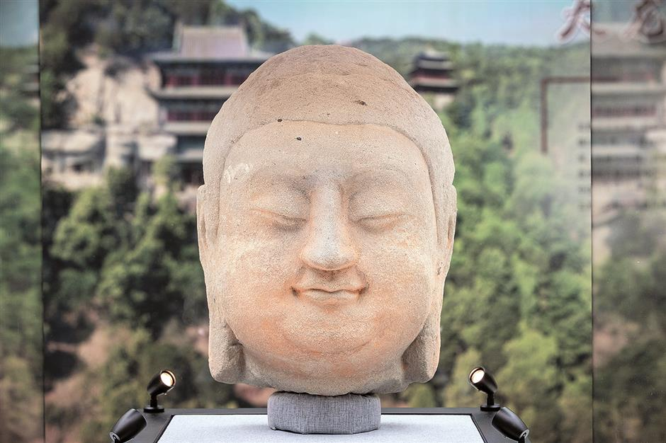 Stolen Buddha statue comes home to China