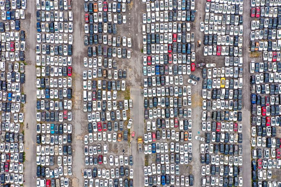 Car 'graveyard' a witness to the power of record floods