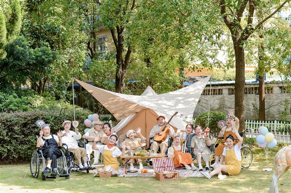 Senior citizens in nursing home film joyful music video