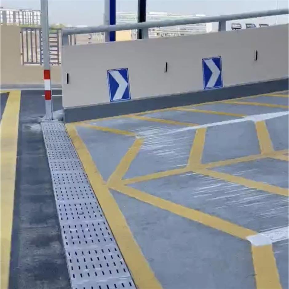 No need for speed as Sam's Club parking lot entrance grates